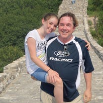 Edward and Quinn McNally, of Rhinebeck, pictured at the Great Wall of China. The two will travel to Super Bowl 50, continuing a family tradition started at Super Bowl I.