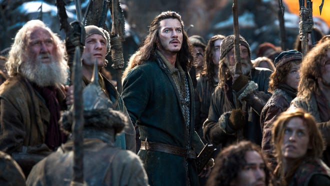 """Peter Jackson's three Hobbit films all were released in a 3D version in the United States. This photo provided by Warner Bros. Entertainment shows Luke Evans, center, as Bard in the fantasy adventure """"The Hobbit: The Battle of the Five Armies,"""" a production of New Line Cinema and Metro-Goldwyn-Mayer Pictures, released by Warner Bros. Pictures and MGM."""