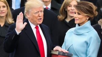 Donald Trump is sworn in as the 45th president of the United States as Melania Trump looks on during the 58th Presidential Inauguration at the U.S. Capitol in Washington on Friday, Jan. 20, 2017.