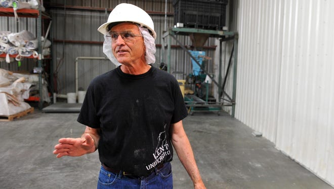 David Oien, co-founder of Timeless, gives a tour of the Timeless processing facility in Ulm.