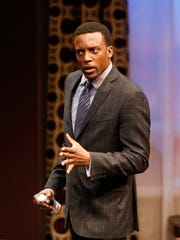 """Lewis (Garrett Lee Hendricks) is a television sports producer in """"Playing the Assassin"""" at the Delaware Theatre Company."""