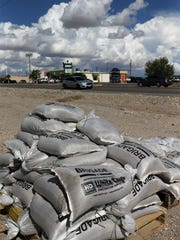 Sandbags are shown on a pallet Friday outside the Road