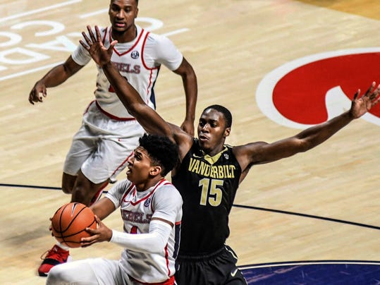 Mississippi's Breein Tyree (4) shoots against Vanderbilt's Clevon Brown (15) during an NCAA college basketball game, Saturday, March 3, 2018, in Oxford, Miss. Vanderbilt beat Mississippi 82-69. (Bruce Newman/The Oxford Eagle via AP)
