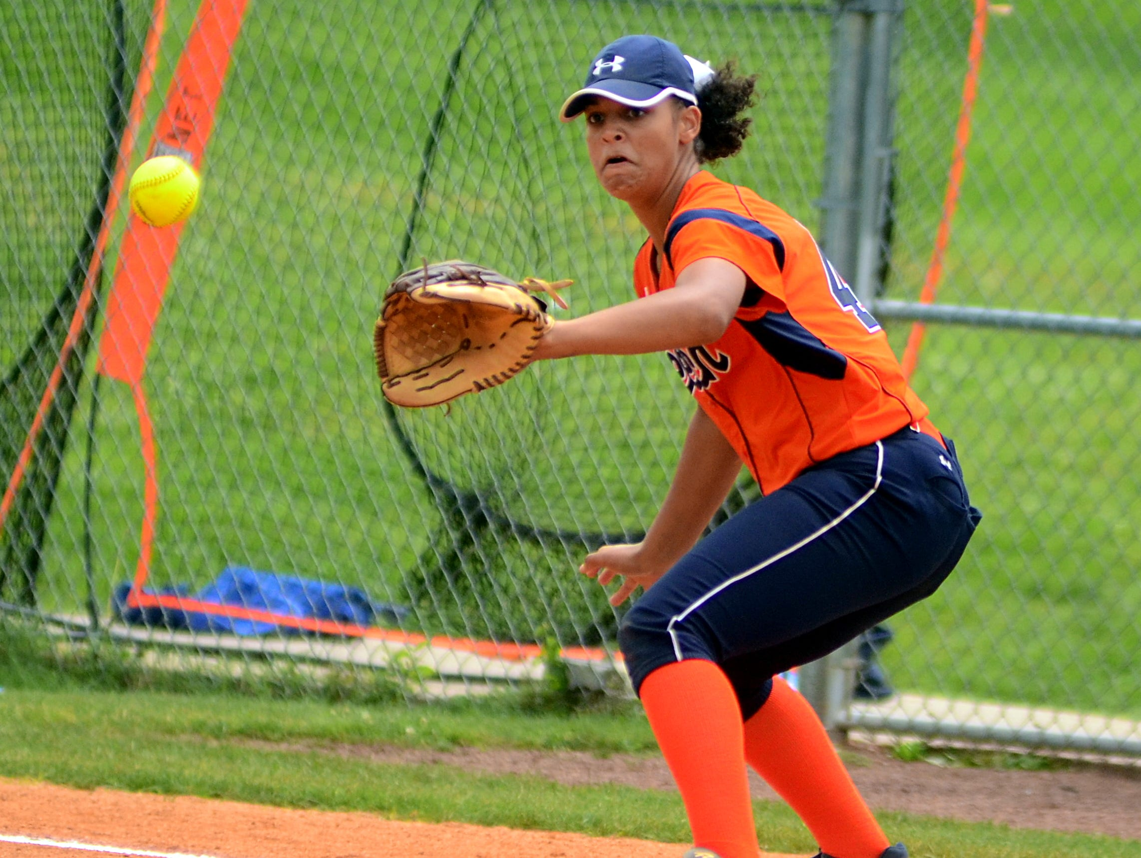 Beech High sophomore first baseman Kennedy McCurry receives a throw during third-inning action.