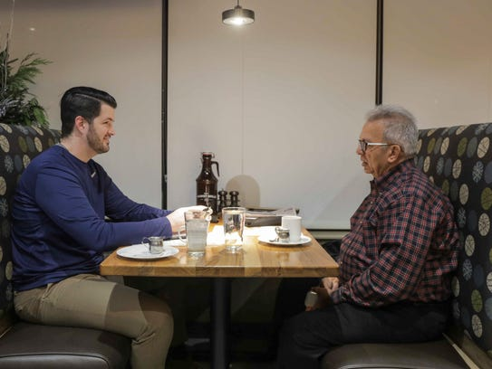 Suku Radia talks with West Des Moines chiropractor Josiah Fitzsimmons during a early morning mentoring session at the Hy-Vee Marketplace Grill in West Des Moines. The retiring Bankers Trust CEO has guided hundreds of young professionals through formal and informal mentoring.