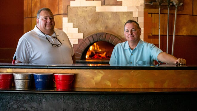 Business partners Chris Hanken, left, and Vic Lanzotti, right, are the owners of Lake Pointe Grill, which serves up Neapolitan style pizza that is cooked in a wood-fired oven located at 1386 Toronto Road in Springfield.