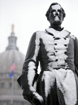 The statue of Col. Hans Christian Heg at the Wisconsin Capitol is covered in snow after a brief storm in Madison on Tuesday.