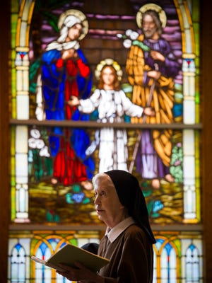 Sister Jane Marie DeLand stands during the daily Office of Readings in the chapel at the Monastery of St. Clare in Evansville, Tuesday, Jan. 17, 2017. Sister Deland has lived at the monastery for the past 25 years, she is one of seven nuns who currently call the monastery home.
