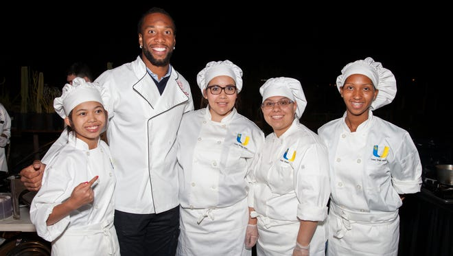 Harvest Moon Dinner 2014 special guest Larry Fitzgerald of the Arizona Cardinals shows support for Casa Grande High School C-CAP students.