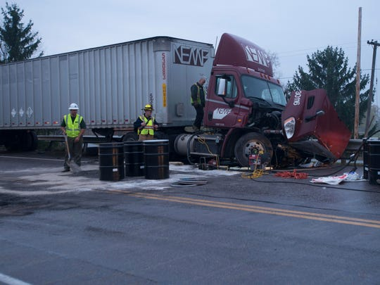 Crews works to clean up fuel at a fatal crash involving a tractor trailer and a car that killed one person on U.S. 7 in Shelburne early Thursday morning.