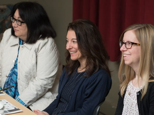 Robin L. Flanigan, center, is a freelance writer who landed a part in Listen to Your Mother 2016 in Rochester.