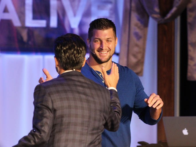 Tim Tebow, a former NFL player and current college football analyst for ESPN, speaks at Our Savior's Church in Opelousas, La., Sunday, April 20, 2014.