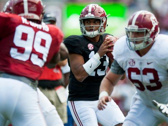 Alabama quarterback Tua Tagovailoa (13) looks to throw