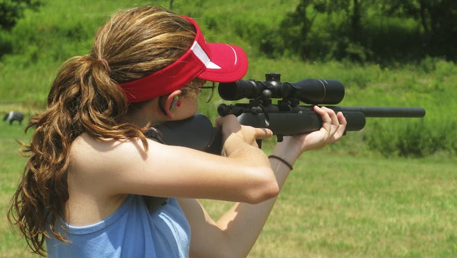 Brianna Rathbun, of Troy, takes aim during the 2014 NRA Youth Hunter Education Challenge national championship near Mansfield.