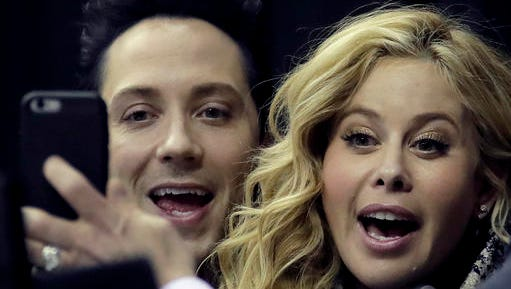 Johnny Weir and Tara Lipinski pose for a photo while working the broadcast at the U.S. Figure Skating Championships on Friday, Jan. 20, 2017, in Kansas City, Mo. (AP Photo/Charlie Riedel)