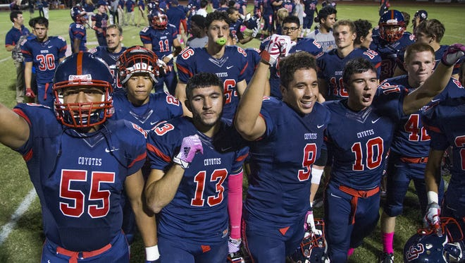 Centennial High School players celebrate the overtime victory over Chaparral High School at Centennial, Friday, October 9, 2015.  The final score was 20-17.  #HSfb