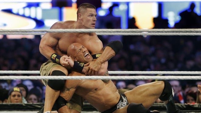 Wrestler John Cena, top,is among the stars who could be at WrestleMania 2018 in New Orleans.