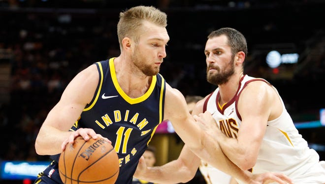 Indiana Pacers forward Domantas Sabonis (11) gets defended by Cleveland Cavaliers forward Kevin Love (0) during the second quarter at Quicken Loans Arena.