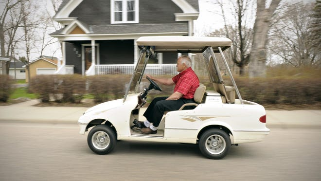 Frank Osendorf drives his golf cart May 6, 2014 in St. Joseph. Stearns County is revisiting its golf cart rules after they lapsed in May 2018 due to a sunset clause in the policy.