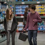 "This photo provided by Twentieth Century Fox shows Cara Delevingne, left, as Margo, and Nat Wolff as Quentin, in a scene from the film, ""Paper Towns."""