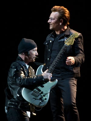 """U2's the Edge (left) and Bono kick off their world tour marking the 30th anniversary of """"The Joshua Tree"""" in Vancouver, B.C., on May 12, 2017."""