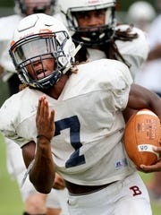 Blackman's Micaleous Elder (7) runs the ball during