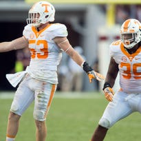 Tennessee linebacker Colton Jumper (53) and lineman Kendal Vickers (39) celebrate after Jumper intercepted the ball from Texas A&M quarterback Trever Knight (8) on Saturday, October 8, 2016. (SAUL YOUNG/NEWS SENTINEL)