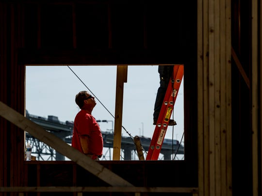 Contractors work on the new dorms for Baker College's