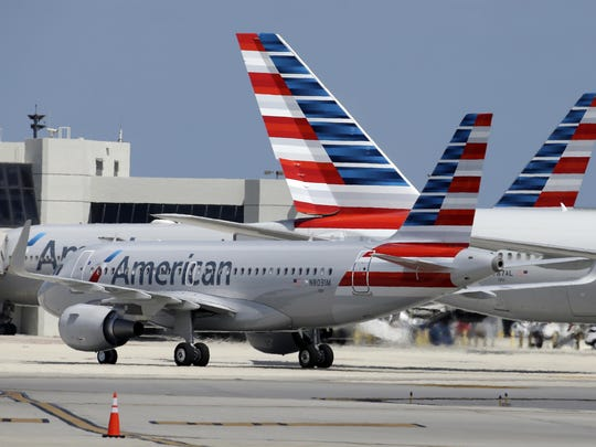 In this Wednesday, May 27, 2015, file photo, an American Airlines jet taxis to the gate at Miami International Airport, in Miami.