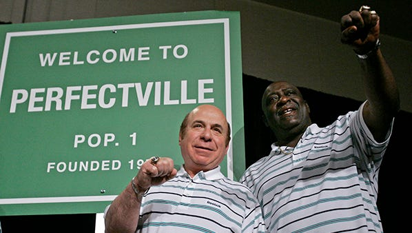 In this 2008 photo, former Miami players Garo Yepremian and Larry Little talk about the Dolphins' perfect season in 1972.