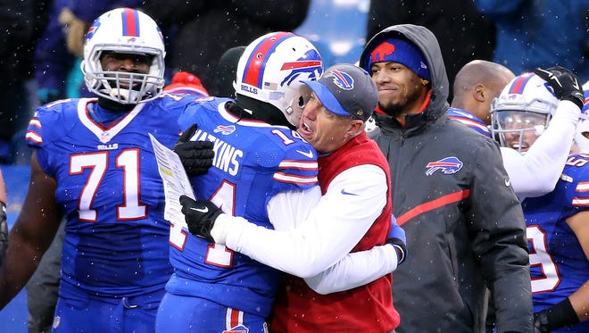 Bills head coach Rex Ryan shares a hug with receiver Sammy Watlkins,  The Bills beat the Jets 22-17 to knock them out of the playoff picture.