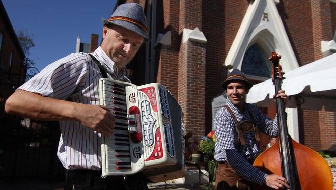Nermin Begovich, left, and Sam Frazee play polka music for the crowd at Oktoberfest in Nashville on Saturday.