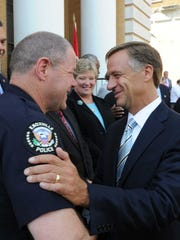 Gov. Bill Haslam, right, greets Knoxville Police Chief David Rausch on Jun. 6, 2011 at the Greene County Courthouse.