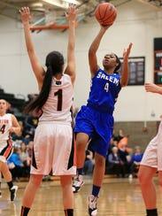 Lofting a shot Tuesday is Salem senior Jamyra Wilson