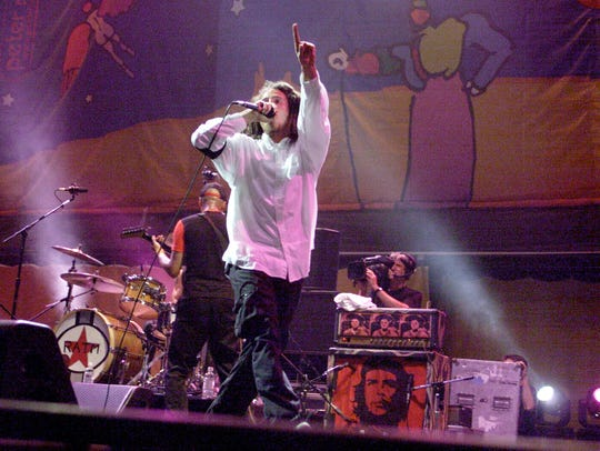 Rage Against the Machine perform at Woodstock '99 at