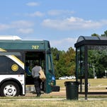 A JATRAN bus picks up a passenger Friday at the bus stop on the I-55 frontage road by Target in north Jackson.
