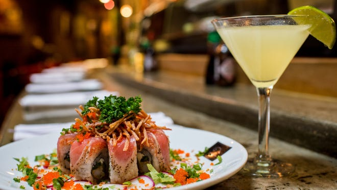 The Hung Lo roll and Hunk Martini are served at Tsunami Sushi in downtown Lafayette, La., Tuesday, Nov. 3, 2015.