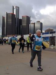 Carol Dean of Rochester runs in the 2014 Free Press