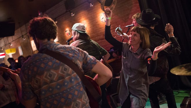 People hop on stage to dance to Grayson County Burn Ban at Surfside 7 on the second day of FoCoMX on Saturday, April 29, 2017.