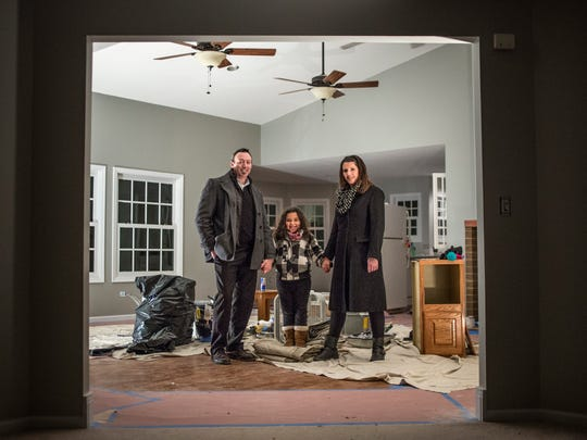 Brian and Christine Fitzpatrick with their daughter, Alia, 6, Thursday, Jan. 5, 2017 at their new home in Fort Gratiot.