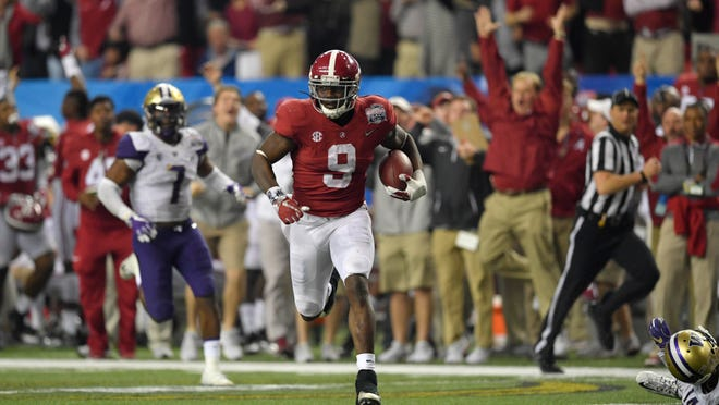 Dec 31, 2016; Atlanta, GA, USA;  Alabama Crimson Tide running back Bo Scarbrough (9) runs the ball for a touchdown against the Washington Huskies during the fourth quarter in the 2016 CFP semifinal at the Peach Bowl at the Georgia Dome. Mandatory Credit: Dale Zanine-USA TODAY Sports ORG XMIT: USATSI-326270 ORIG FILE ID:  20161231_ajw_sz2_151.jpg