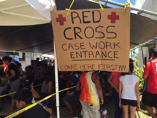 More than 100 Typhoon Soudelor survivors waited in line at the American Red Cross in Saipan around noon Aug. 11, the first day the Red Cross opened a family assistance service center.