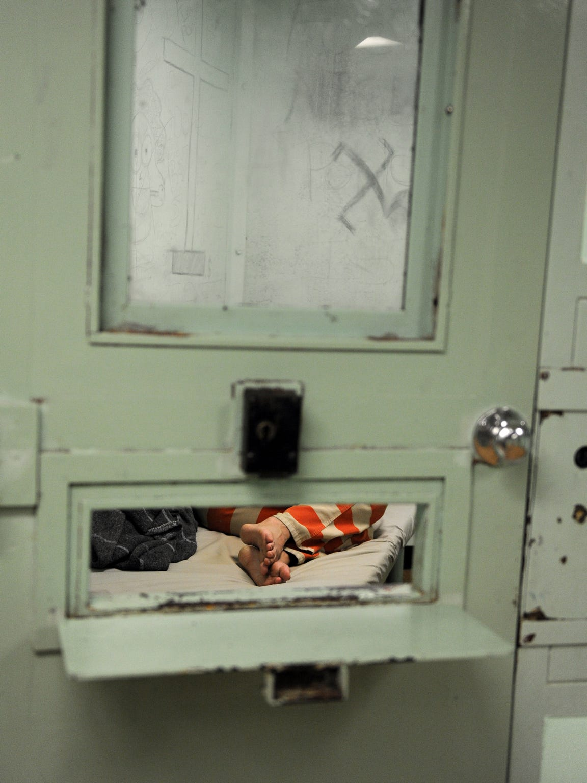 A prisoner sleeps during a mid-morning visit to the