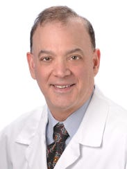 Dr. Gary Miller, director of the Headache Center at