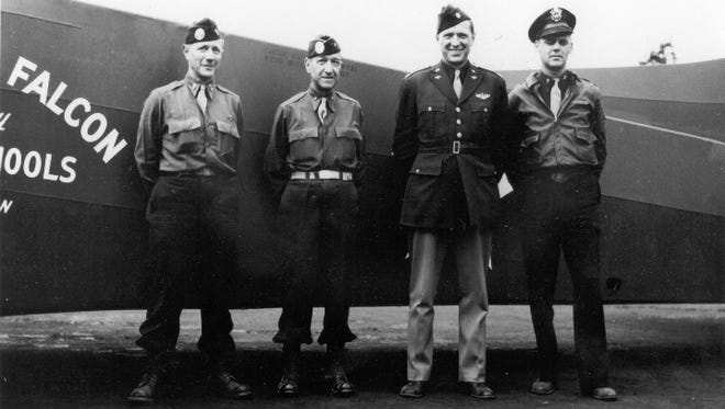"""Brig. Gen. Don F. Pratt (second from left) poses with the passengers and crew of the """"Fighting Falcon."""" Pratt flew in the """"Fighting Falcon"""" as part of the D-Day invasion of Normandy, but was killed when the glider crash-landed in France. Pratt, a University of Wisconsin alum, was the highest-ranking Allied officer killed on D-Day."""
