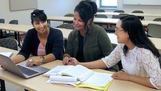 New Mexico State University's Cooperative Extension Service county agents, from left, Marcella Talamante, Laura Bittner and Karim Martinez are doctorial students researching ways to help deliver programs to the under-served population of their counties.