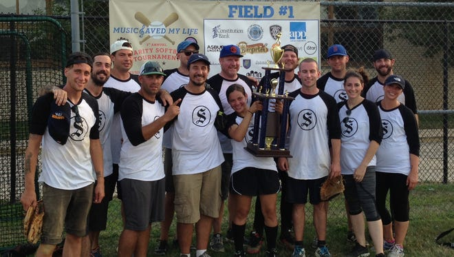 The members of the Smith restaurant group hoist their championship trophy at the  Asbury Park Music Foundation charity softball tournament, Sunday, Aug. 30 at the Asbury Park High School baseball fields.