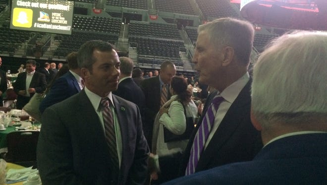 Lafayette Sheriff Mark Garber, left, talks with Bill Curry.