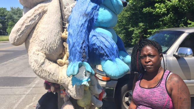 Talishia Collier, at the 4100 block of East 16th Street, where her son was murdered.
