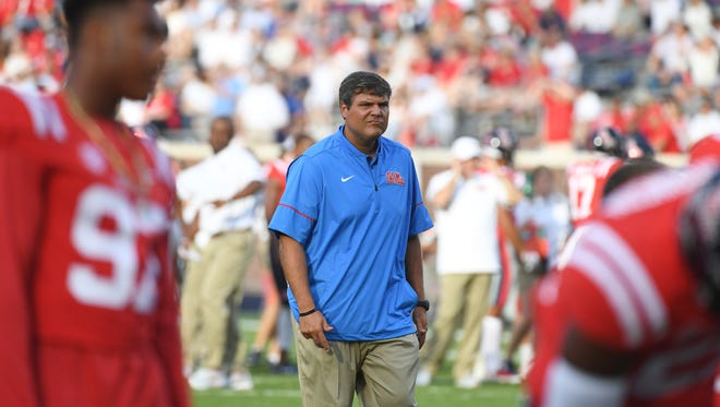 Mississippi head coach Matt Luke watches on during warmups before an NCAA college football game between Mississippi and South Alabama in Oxford, Miss., Saturday, Sept. 2, 2017. (AP Photo/Thomas Graning)
